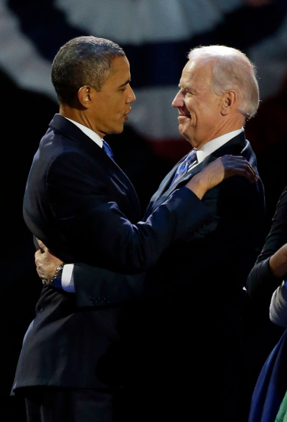 President Barack Obama hugs Vice President Joe Biden after his speech at his election night party Wednesday, Nov. 7, 2012, in
