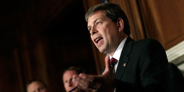 WASHINGTON, DC - OCTOBER 09:  U.S. Sen. Mark Begich (D-AK) (R) speaks at a press conference highlighting how veterans are bei