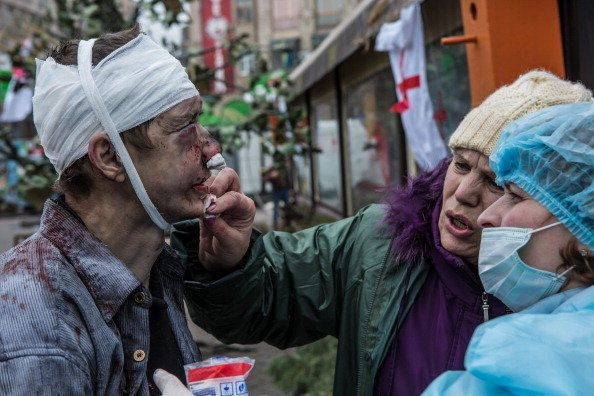 <br>A wounded anti-government protester is treated by medics near Independence Square on Feb. 20, 2014, in Kiev, Ukraine. Aft