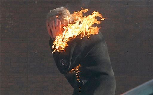 An anti-government protester is engulfed in flames during clashes with riot police outside Ukraine's parliament in Kiev, Ukra