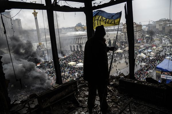 <br>A demonstrator stands on a balcony overlooking Independence square during the face-off against heavily armed police on Fe