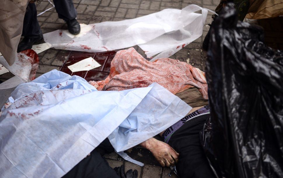 <br>Dead bodies lay covered on the ground during clashes with riot police in central Kiev on Feb. 20, 2014, in Kiev. At least