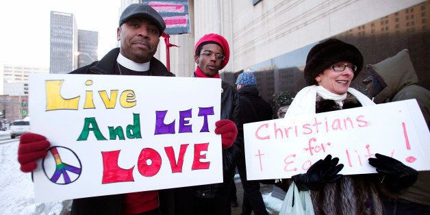 DETROIT, MI - MARCH 3:  Pro-traditional marriage supporters protest next to gay marriage supporters in front of the U.S. Fede
