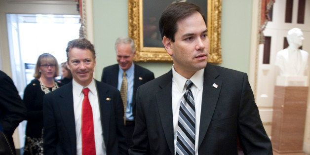 UNITED STATES Ð NOVEMBER 17: From left, Sen.-elect Rand Paul, R-Ky., and Sen.-elect Marco Rubio, R-Fla., leave the Mansfield