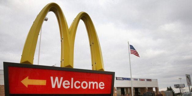 DES PLAINES, IL - OCTOBER 24:  A sign directs customers to the drive-thru at a McDonald's restaurant on October 24, 2013 in D