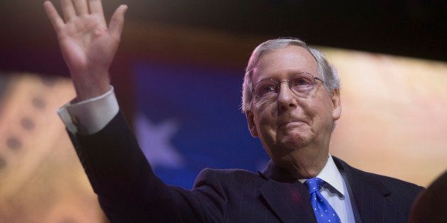 Senate Minority Leader Mitch McConnell, a Republican from Kentucky, gestures after speaking during the Conservative Political