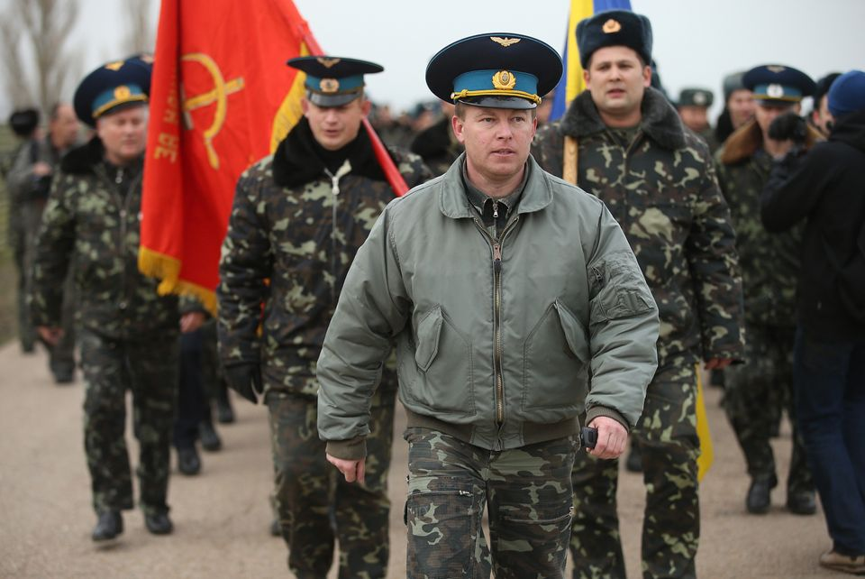 LUBIMOVKA, UKRAINE - MARCH 04:  Colonel Yuli Mamchor (C), commander of the Ukrainian military garrison at the Belbek airbase,