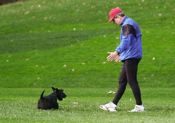U.S. President George W. Bush plays with his dog Barney 16 December 2001 after returning to the White House from his morning