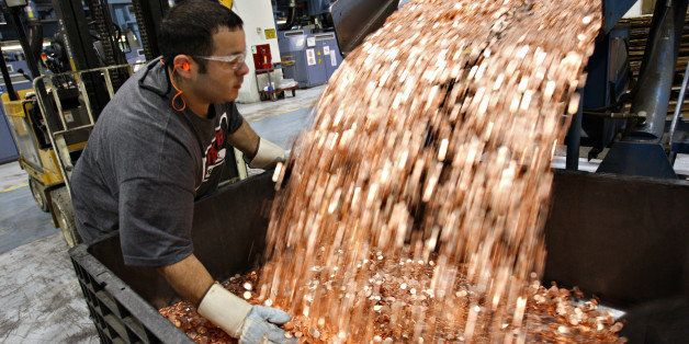 UNITED STATES - AUGUST 08:  Mike Spinosa, a pit driver at the U.S. Mint, transfers one cent blanks before they are struck int