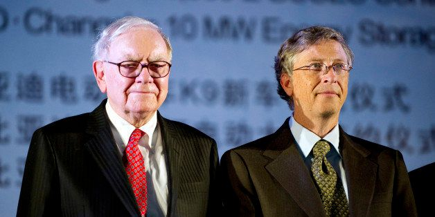 Warren Buffett, chairman of Berkshire Hathaway Inc., left, stands with Bill Gates, of the Bill and Melinda Gates Foundation,