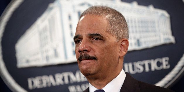 WASHINGTON, DC - MARCH 19:  U.S. Attorney General Eric Holder listens during an announcement at the Justice Department March