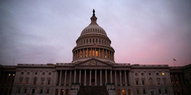 WASHINGTON, DC - MARCH 11: The American Flag flies over the Senate side of the U.S. Capitol, as Senate Democrats speak nonsto