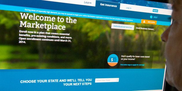 This December 2, 2013 photo shows a woman reading the HealthCare.gov insurance marketplace internet site in Washington, DC. T