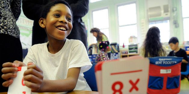 WASHINGTON, DC MARCH 30:  Second grader, Renard Gray, 8, reacts to a problem as he is shown multiplication flash cards by cla
