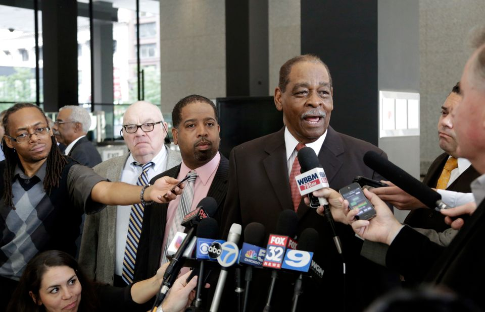 Former Cook County Commissioner William Beavers speaks at a news conference after being sentenced on Wednesday, Sept. 25, 201