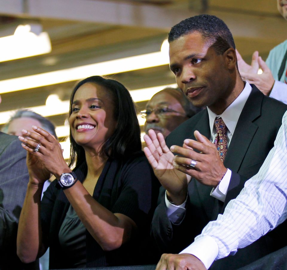 This Aug. 5, 2010 file photo shows then-Rep. Jesse Jackson Jr., D-Ill., right, and his wife, Chicago Alderman Sandi Jackson,