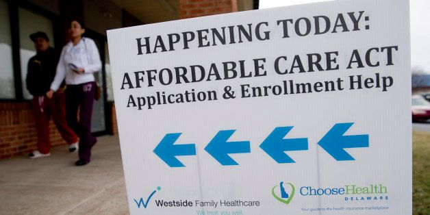 An Affordable Care Act application and enrollment help sign stands outside a Westside Family Healthcare center in Bear, Delaw
