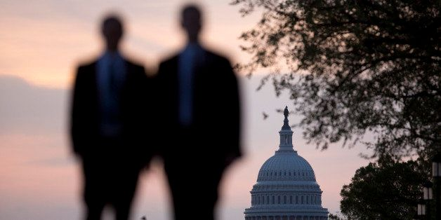 Men walk on the National Mall near the U.S. Capitol in Washington, D.C., U.S., on Monday, April 14, 2014. Republicans need to