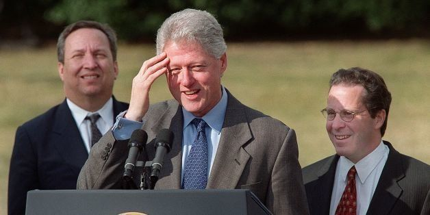 WASHINGTON, :  US President Bill Clinton answers a reporters' question after making a statement on US economic growth 12 Janu