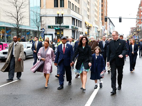 Massachusetts Gov. Deval Patrick walks with his wife, Diane (left), and the family of Martin Richard, the 8-year-old boy kill