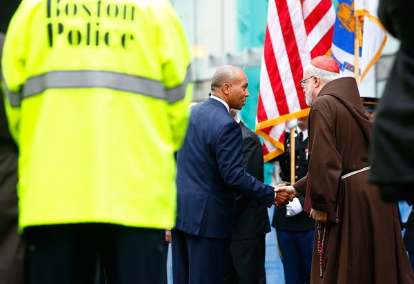 Gov. Deval Patrick shakes hands with Cardinal O'Malley.