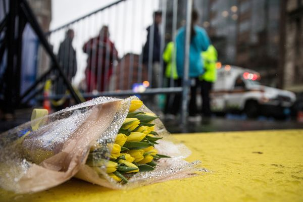 Flowers lie at the finish line of the Boston Marathon.