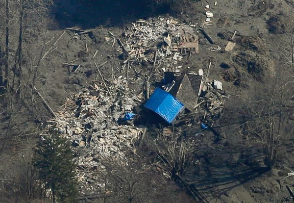 A house destroyed by the massive mudslide that killed at least eight people and left dozens missing is shown in this aerial p
