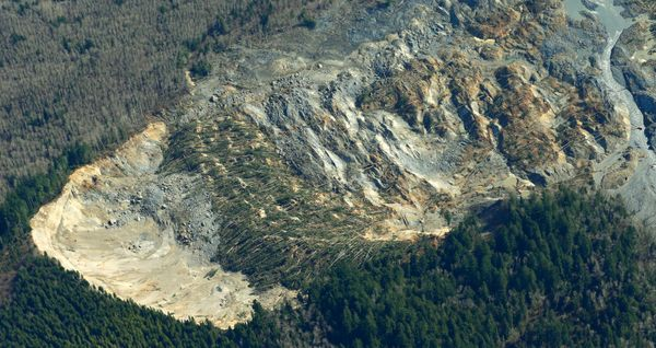 The massive mudslide that killed at least eight people and left dozens missing is shown in this aerial photo,