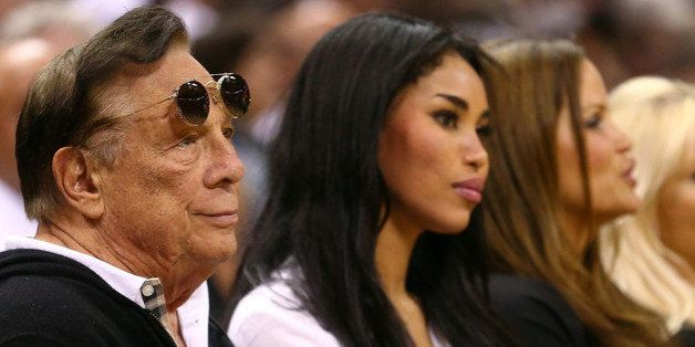 SAN ANTONIO, TX - MAY 19:  (2nd L) Team owner Donald Sterling of the Los Angeles Clippers watches the San Antonio Spurs play