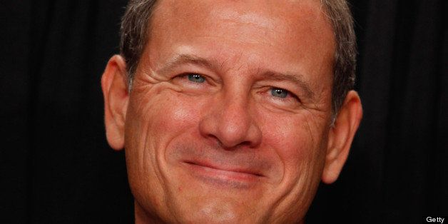 WASHINGTON - OCTOBER 08:  U.S. Supreme Court Chief Justice John Roberts poses for photographs in the East Conference Room at