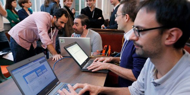 Software developers work on laptops during the 'Hackathon Dataculture', a one-or two-day hack event dedicated to open cultura