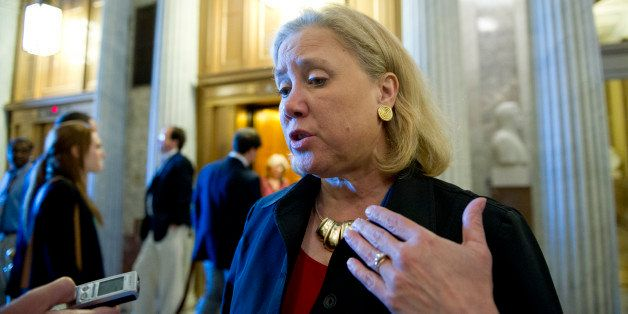 UNITED STATES - June 4: Sen. Mary Landrieu, D-LA., talks to reporters as she walks to the weekly Senate policy luncheons in t