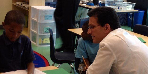 Rep Eric Cantor (R-Va),  the author of a bill to replace the No ChildLeft Behind Act, talks to a student at Two Rivers Public