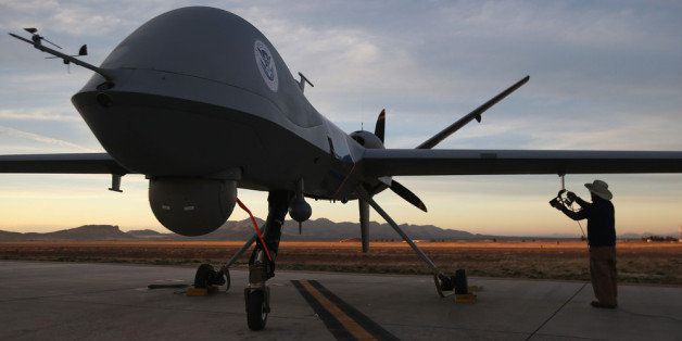 SIERRA VISTA, AZ - MARCH 07:  Maintenence personel check a Predator drone operated by U.S. Office of Air and Marine (OAM), be