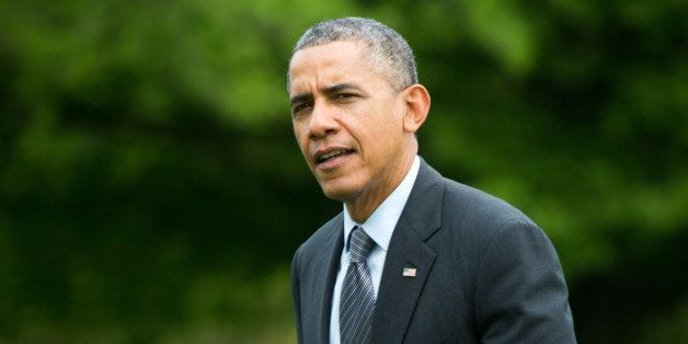 WASHINGTON, DC - MAY 9, 2014 :  U.S. President Barack Obama walks from Marine One as he returns to the White House on May 9,