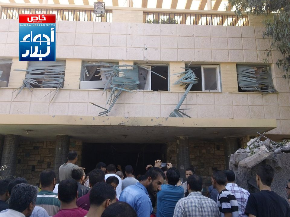 This image provided by Ajwaa Leblad News, which is consistent with other AP reporting, shows the aftermath of a car bomb atta