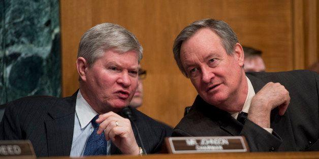 UNITED STATES - FEBRUARY 27: Chairman Tim Johnson, D-S.D., left, and Sen. Mike Crapo, R-Idaho, ranking member, conduct Senate