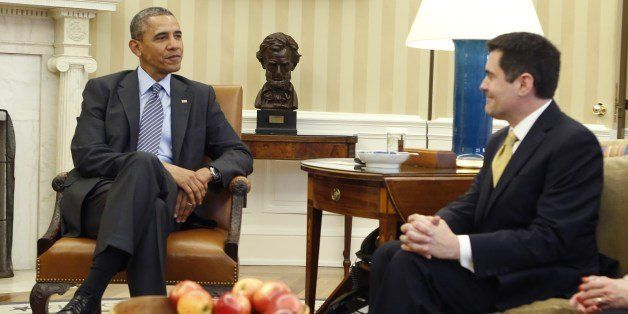 US President Barack Obama (L) talks to Dr. Russell Moore, Southern Baptist Convention, Nashville, TN and Suzii Paynter, Execu