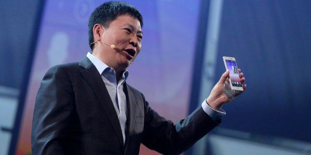 Richard Yu, head of consumer business for Huawei Technologies Co., holds the company's Ascend P7 smartphone during the handse
