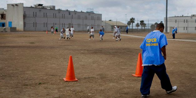Inmates play soccer in the yard at the Richard J. Donovan Correctional Facility in San Diego, California,...
