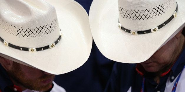 TAMPA, FL - AUGUST 28:  Delegates from Texas wear cowboy hats during the Republican National Convention at the Tampa Bay Time