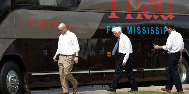 UNITED STATES - MAY 30: Sen. Thad Cochran, R-Miss., and his staff make their way to their bus after a tour of City Hall in Ol