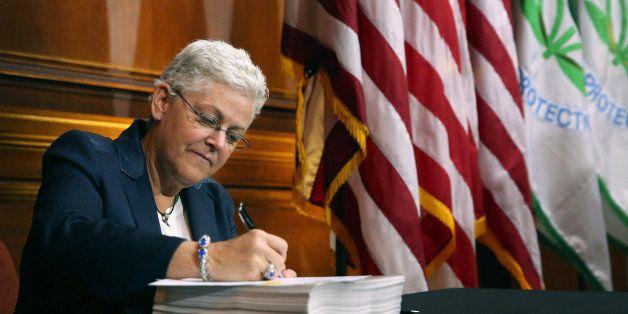 WASHINGTON, DC - JUNE 02:  U.S. Environmental Protection Agency Administrator Gina McCarthy signs new regulations for power p