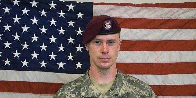 UNDATED - In this undated image provided by the U.S. Army, Sgt. Bowe Bergdahl poses in front of an American flag. U.S. offici
