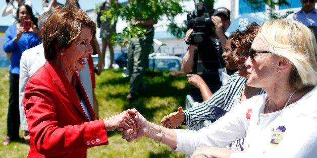 HYDE PARK, MA - JUNE 2:  Leader Nancy Pelosi shakes hands with members of the crowd at a When Women Succeed, America Succeeds