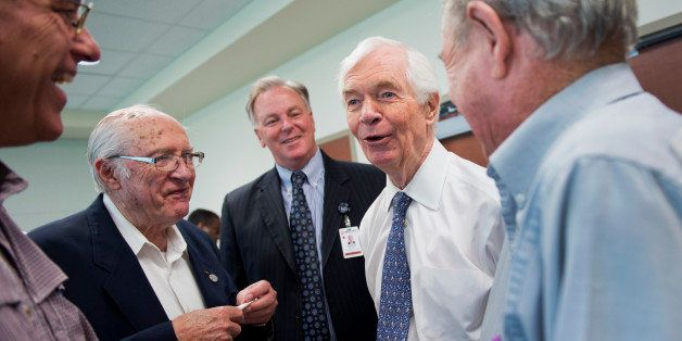 UNITED STATES - MAY 30: Sen. Thad Cochran, R-Miss., second from right, talks with Pat Woods, left, his father Tommy, David Ba