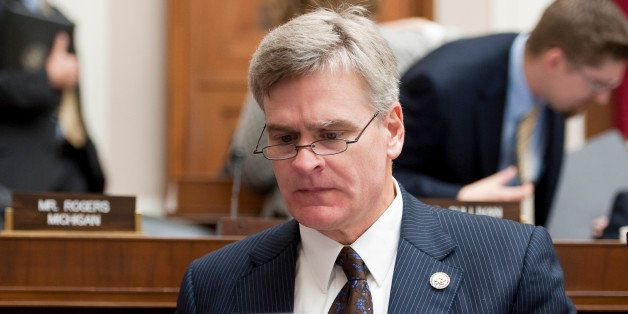 UNITED STATES – NOVEMBER 30: Rep. Bill Cassidy, R-La., works on his laptop during theHouse Energy and Commerce Committee ma