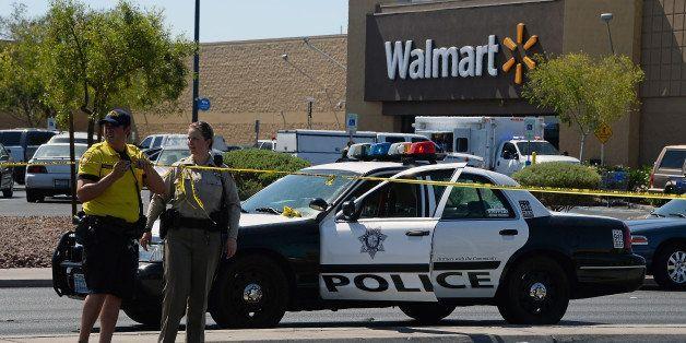LAS VEGAS, NV - JUNE 08:  Las Vegas Metropolitan Police Department officers put police tape up outside a Wal-Mart on June 8,