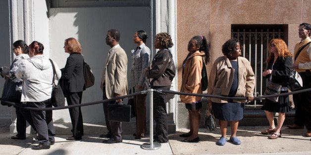 Job seekers wait on line outside the Metropolitan Pavilion before the start of a job fair in New York, U.S., on Sunday, Oct.