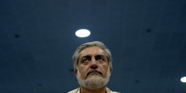 Afghan presidential candidate Abdullah Abdullah attends a gathering on the last day of campaigning in Kabul on June 11, 2014.